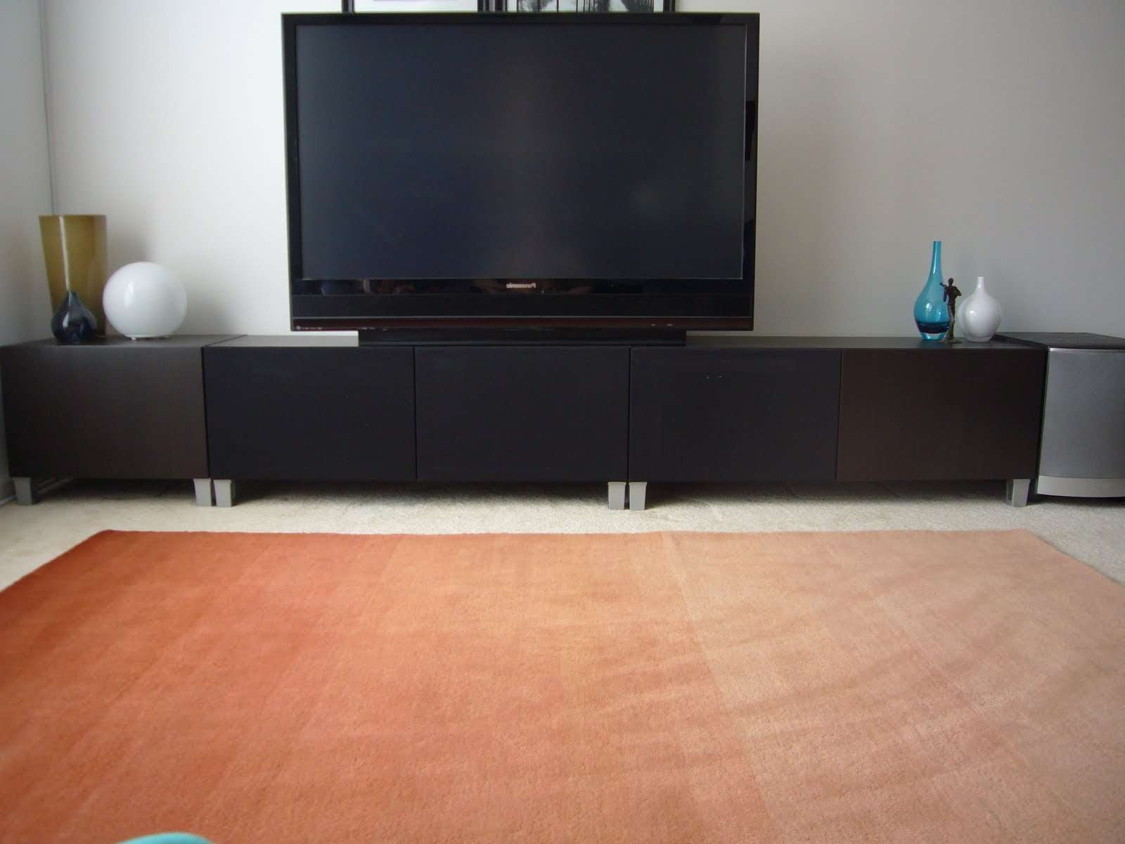 Ikea Besta Tv Stand With Black Tv O Top Long Black Wooden Cabinet Pertaining To Long Tv Stands Furniture (View 7 of 15)