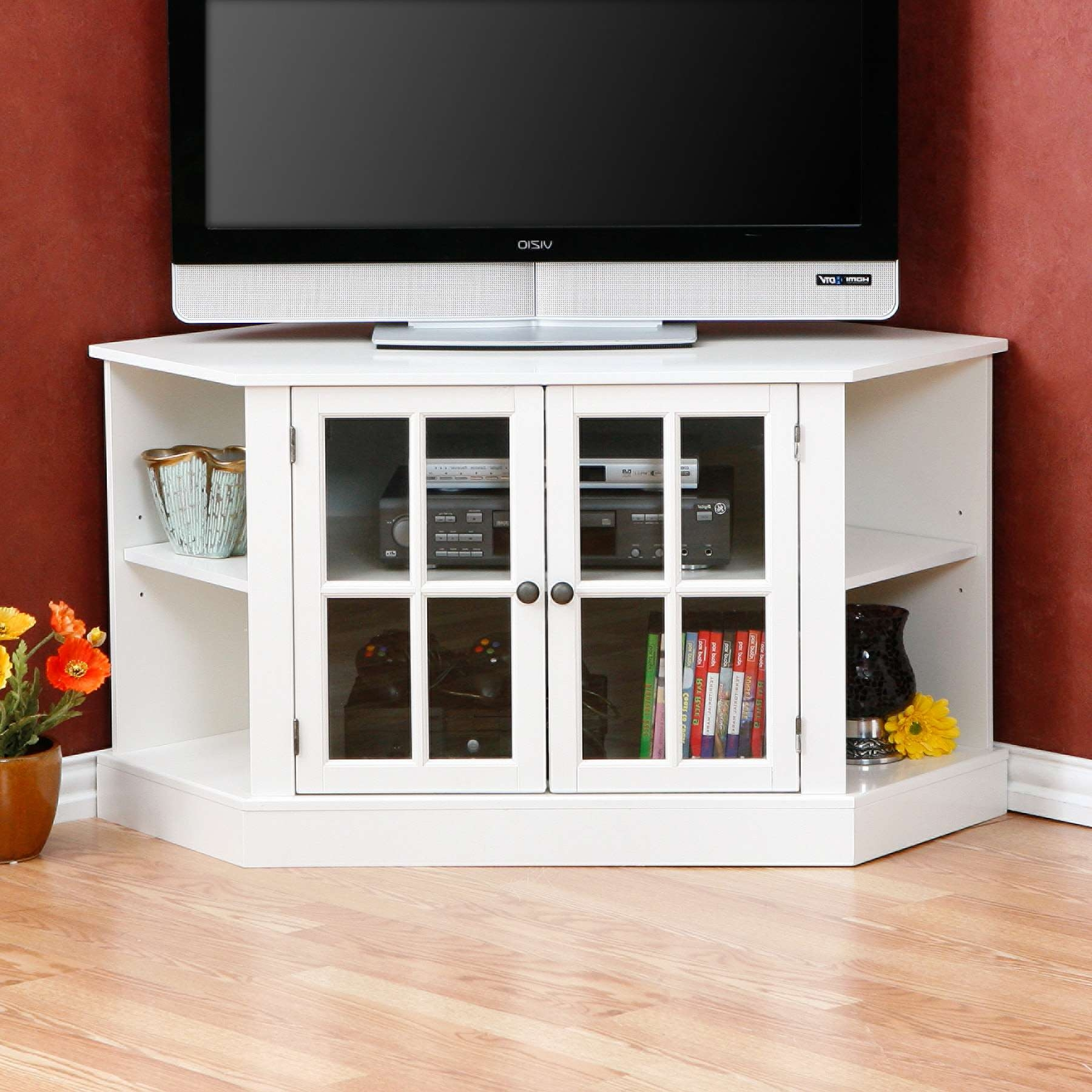 White Wooden Tv Stand With Shelves And Doors On Brown Wooden Floor Pertaining To White Wood Corner Tv Stands (View 4 of 15)