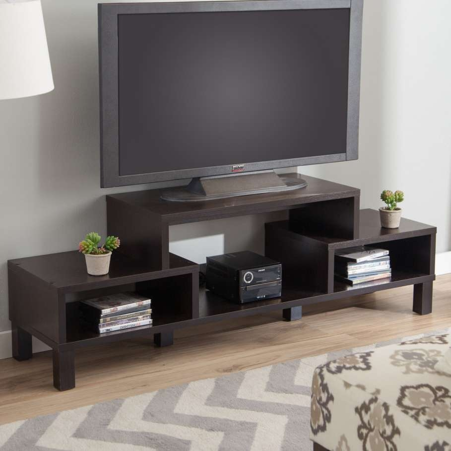 Big Led Tv On Unusual Tv Stands With Cute Flower Vase Above Books Regarding Led Tv Cabinets (View 17 of 20)