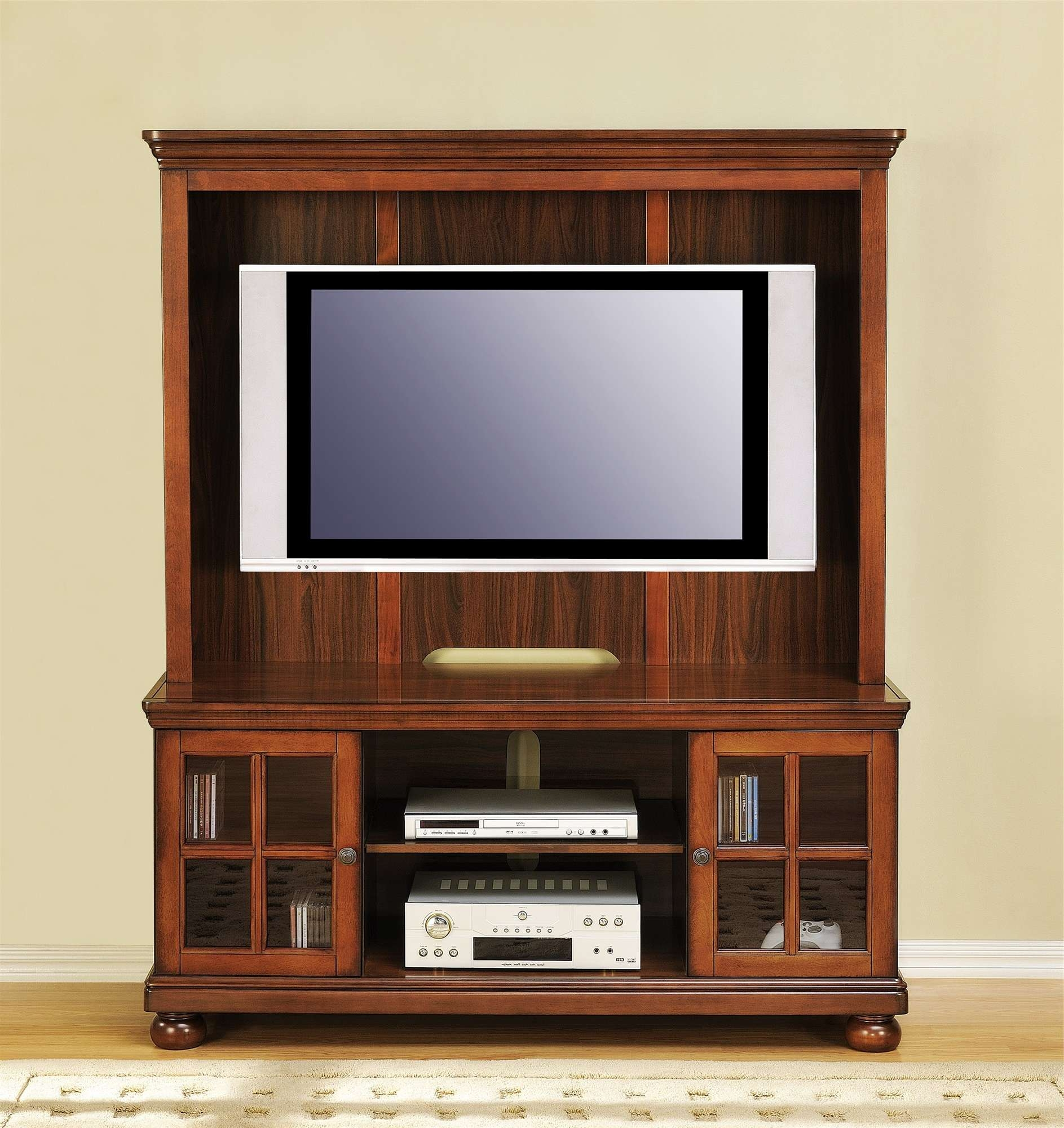 Brown Wooden Tv Cabinet With Glass Frosted Doors On The Floor Within Wooden Tv Cabinets With Glass Doors (View 1 of 20)