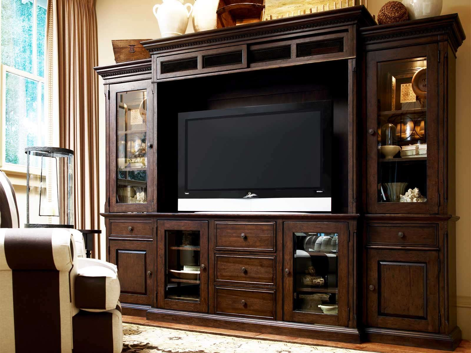 Dark Brown Wooden Tv Cabinet With Doors And Drawers On The Floor With Regard To Wooden Tv Cabinets With Glass Doors (View 2 of 20)