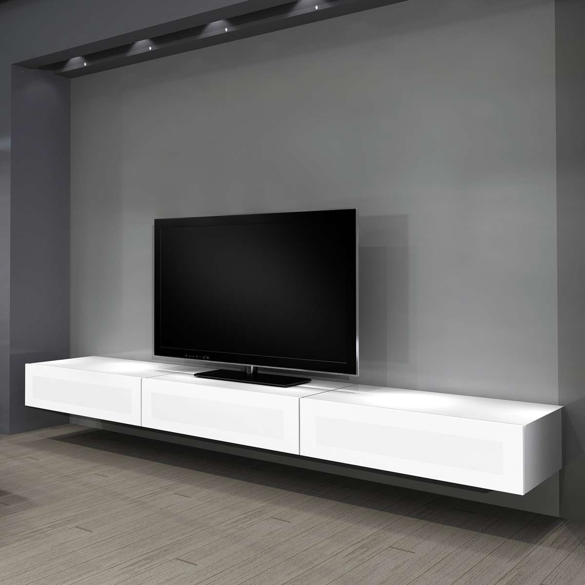 Floating Long White Wooden Cabinet With Tv On The Top Placed On Pertaining To Long White Tv Cabinets (View 11 of 20)
