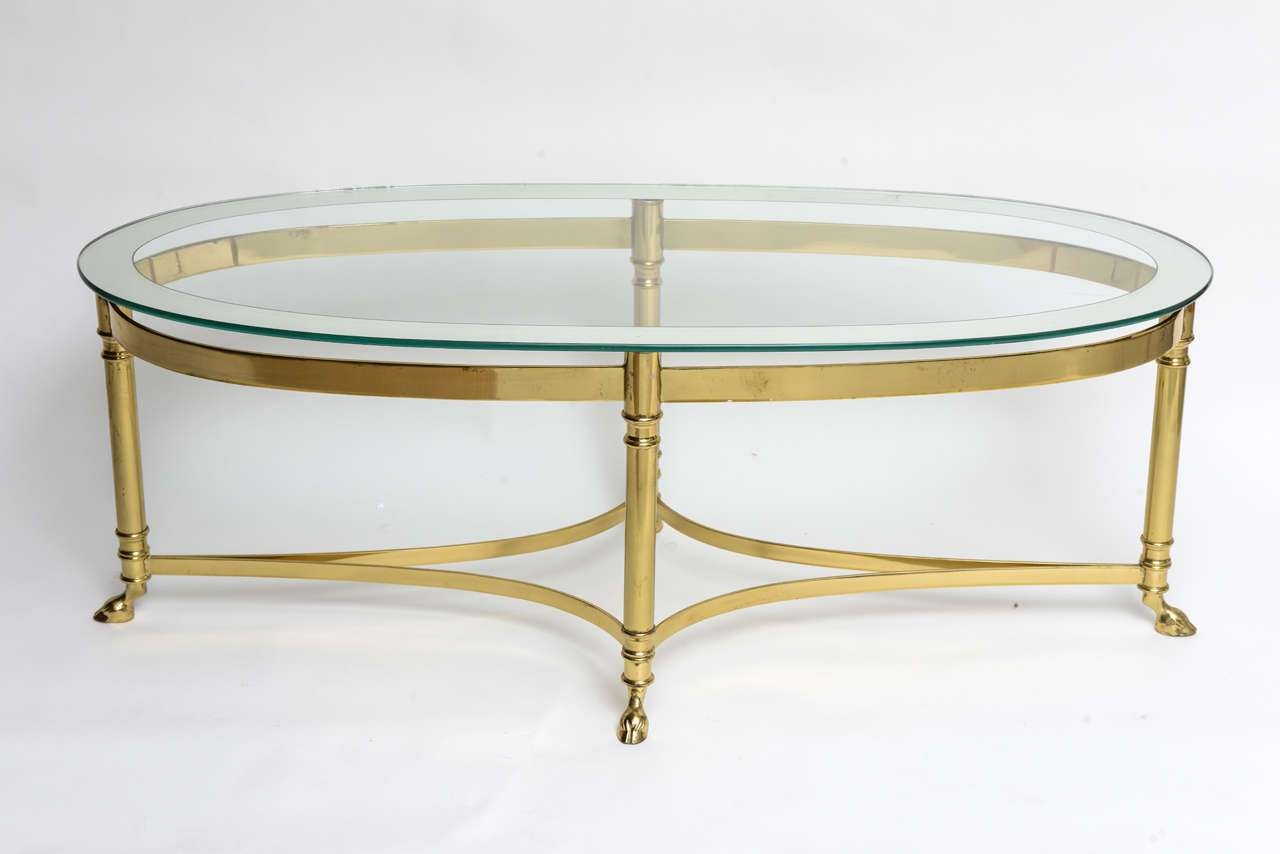 Glass Top Oval Mirrored Coffee Table With Brass Frame And Legs On In Widely Used Round Mirrored Coffee Tables (View 7 of 20)