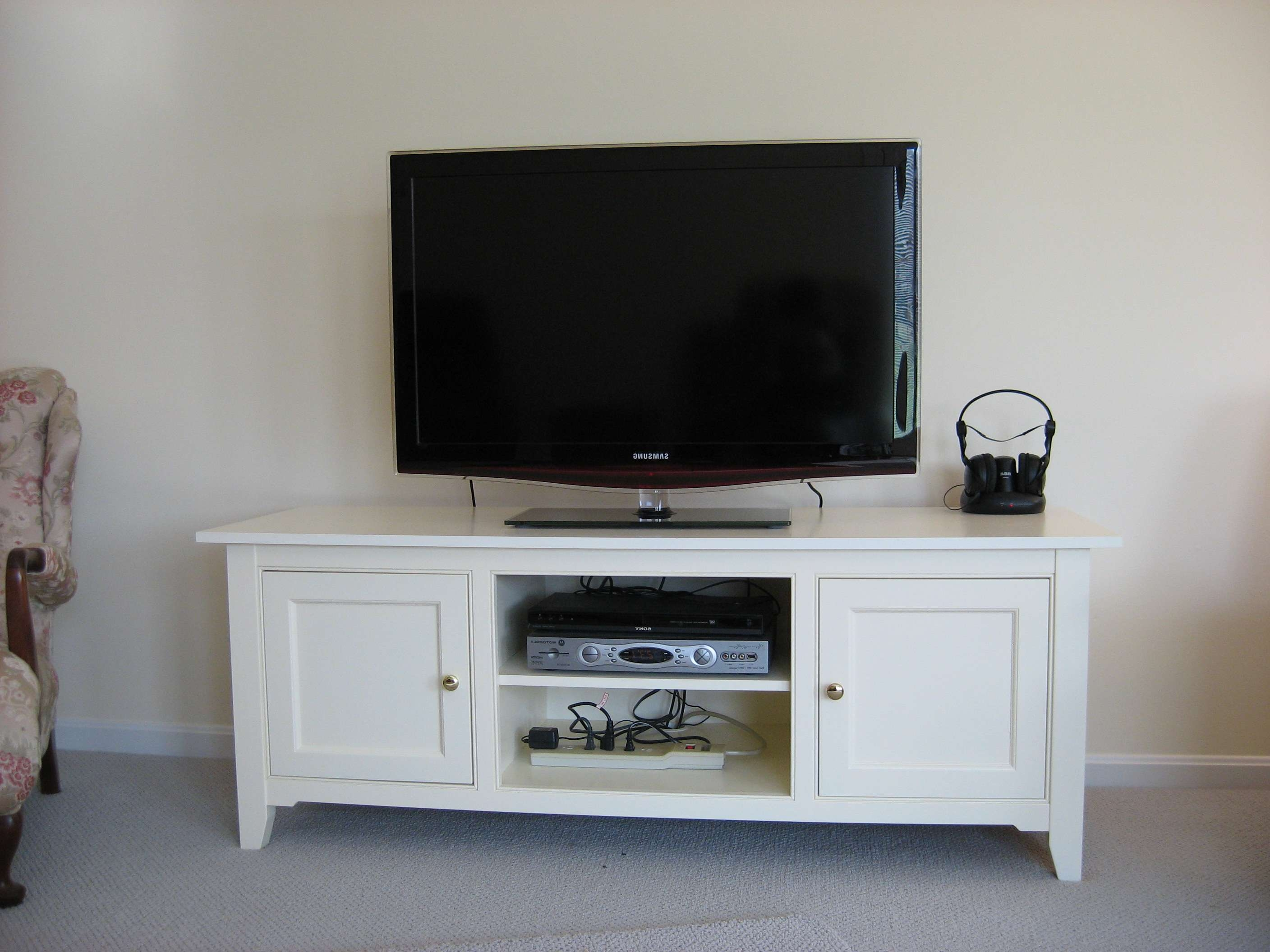 Long Black Wooden Tv Stand With Three Storage Having Glass Doors In Long White Tv Cabinets (View 12 of 20)