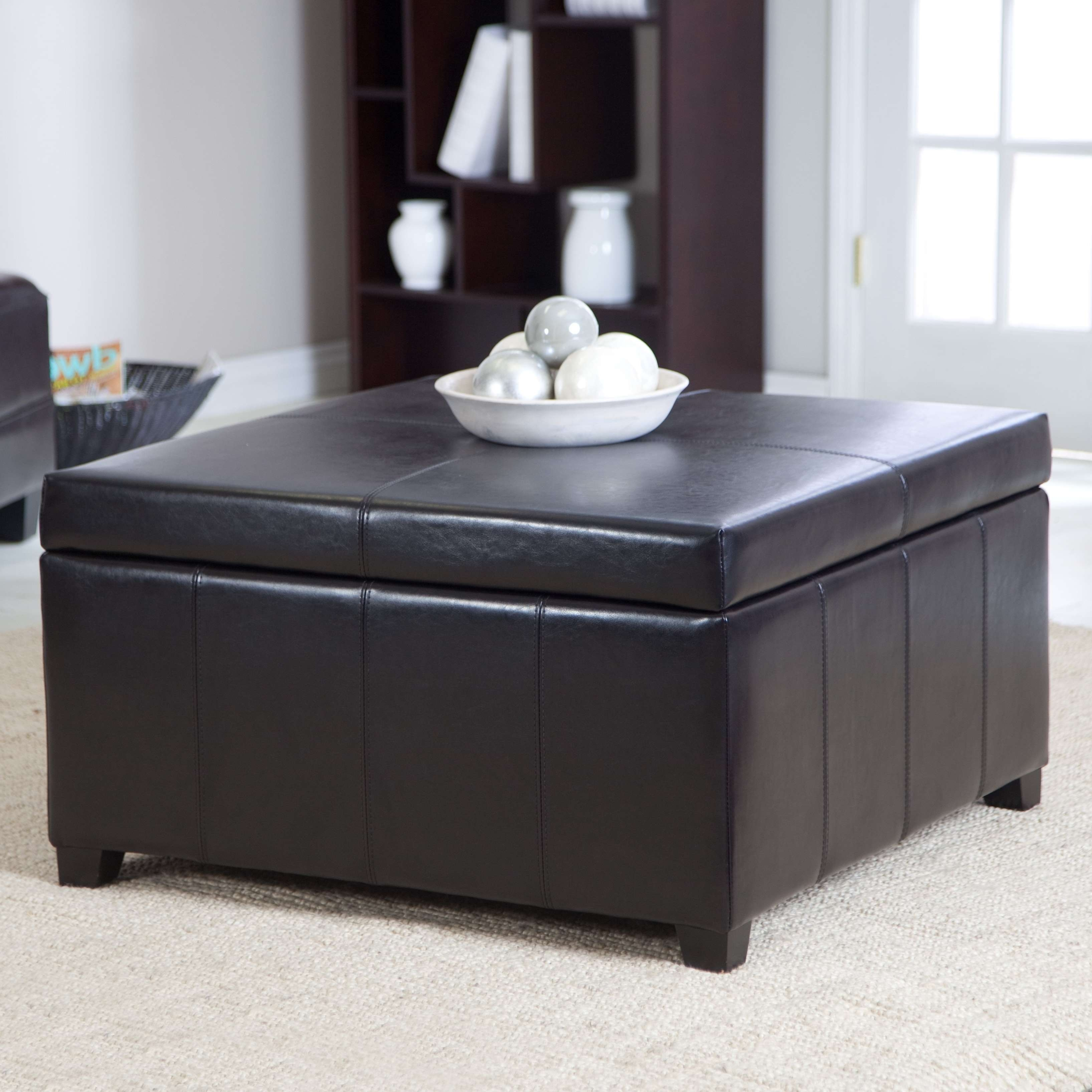 Most Current Brown Leather Ottoman Coffee Tables With Storages Regarding Cube Black Leather Ottoman With Storage Placed On The White Rug Of (View 12 of 20)