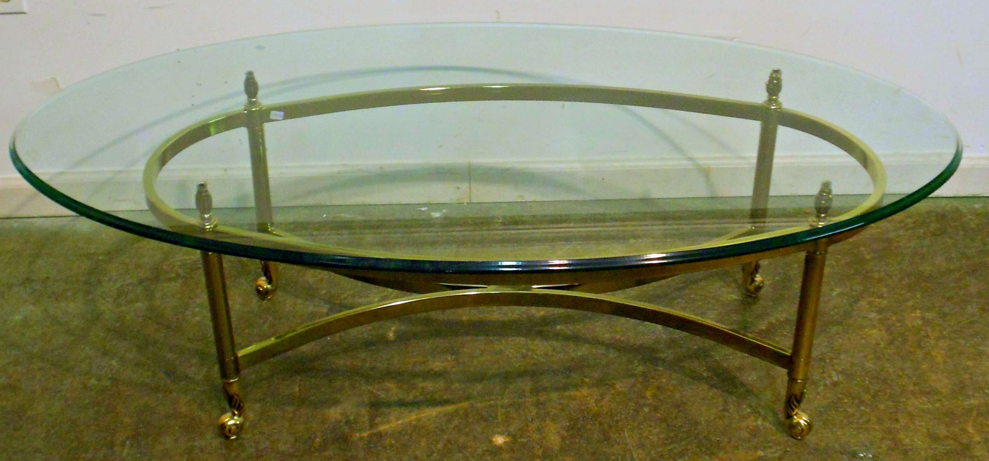 Oval Glass Top Coffee Table With Brass Frame And Wheels For Regarding Well Liked Oval Glass And Wood Coffee Tables (View 15 of 20)