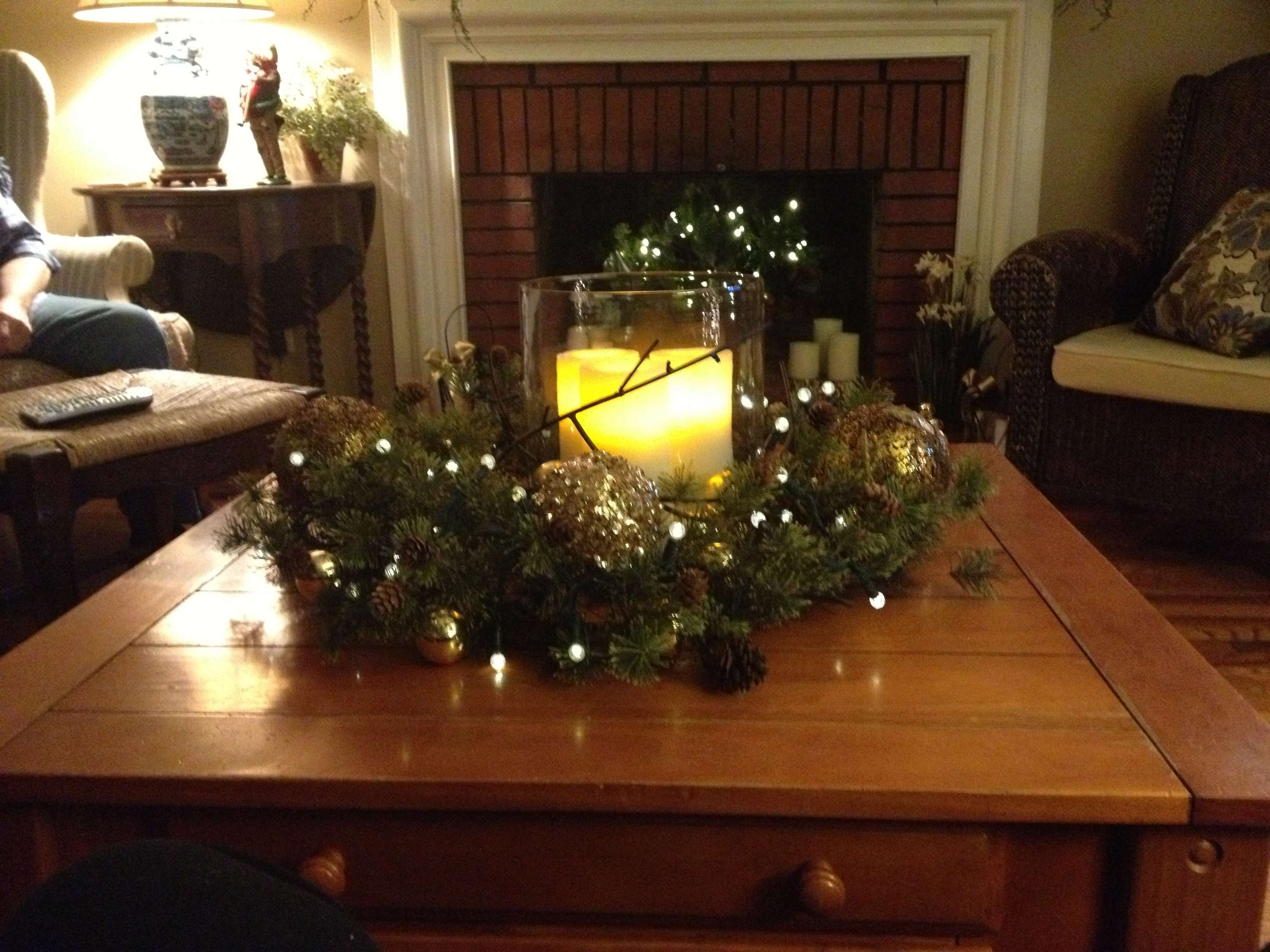 Pinecone With Greenery And Yellow Candle In Clear Big Cup Intended For Latest Rustic Christmas Coffee Table Decors (View 12 of 20)