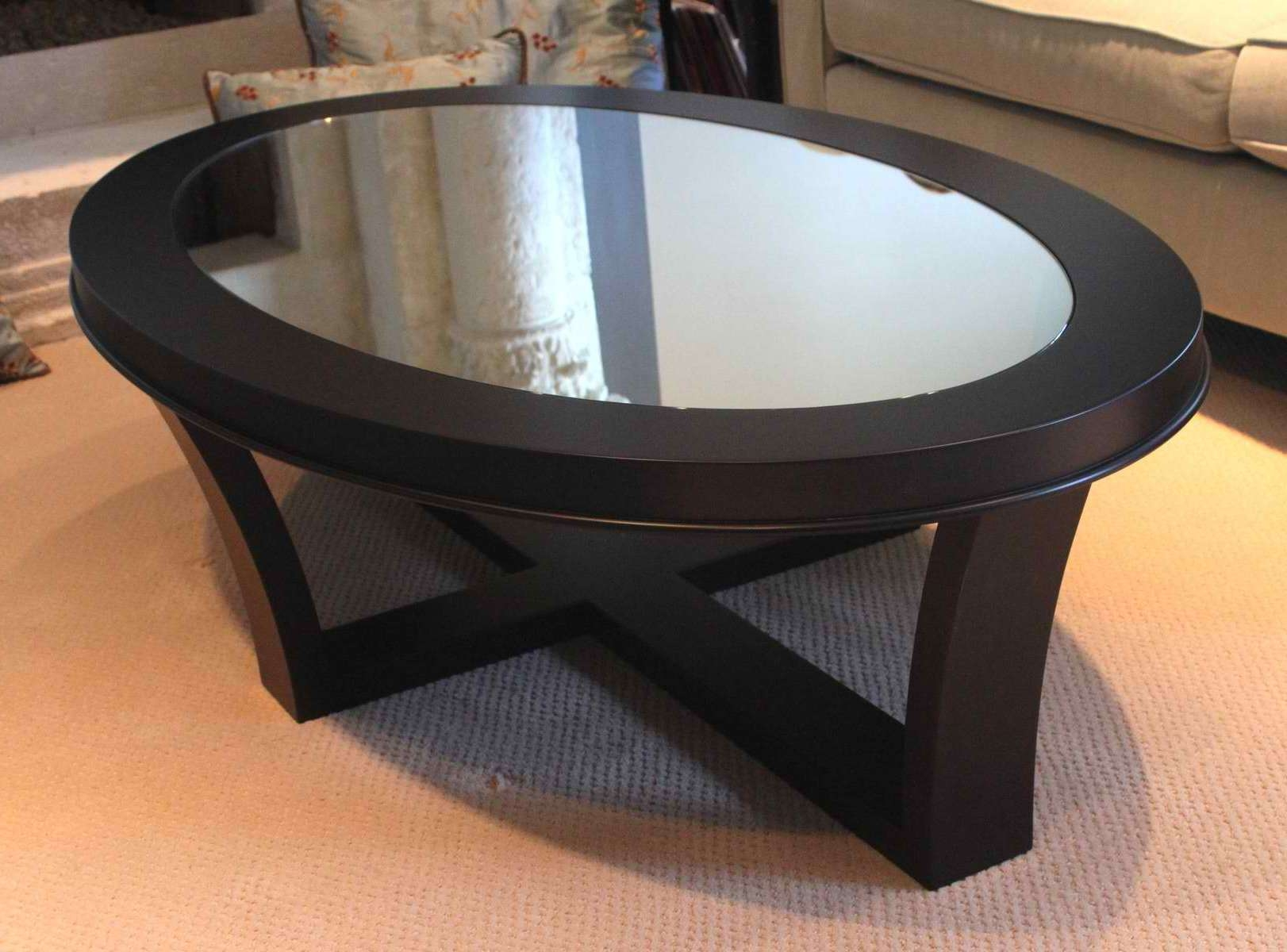 Recent Black Glass Coffee Tables Pertaining To Oval Glass Top Coffee Table With Storage And Wooden Base With (View 11 of 20)