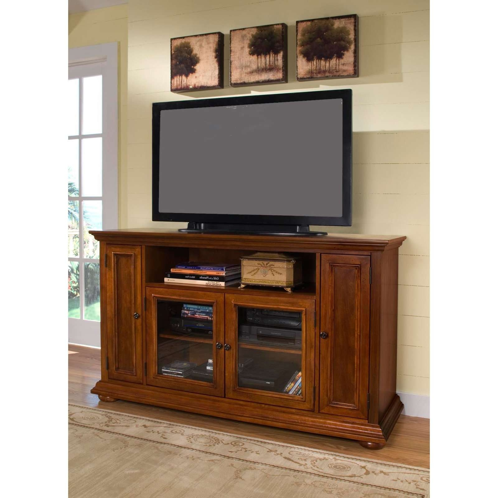 Rectangle Black Flat Screen Tv Over Brown Wooden Cabinet With Pertaining To Wooden Tv Cabinets With Glass Doors (View 4 of 20)