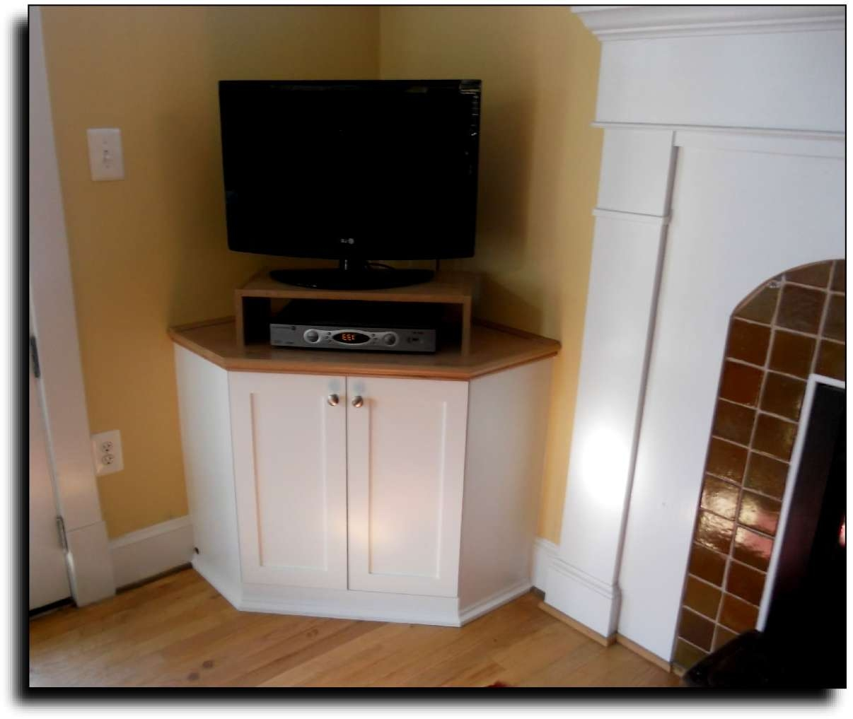 Tall Corner Tv Stand: Designs And Images | Homesfeed Pertaining To Tall Tv Cabinets Corner Unit (View 11 of 20)