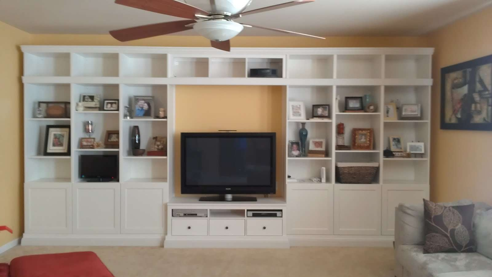 White Ikea Besta Entertainment Center With Recessed Lighting And Inside Ikea Built In Tv Cabinets (View 2 of 20)