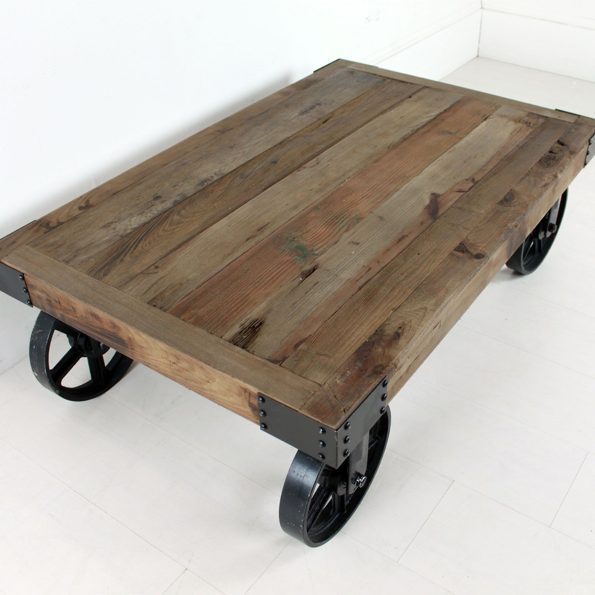 Cason With Regard To Best And Newest Natural Wheel Coffee Tables (View 1 of 20)