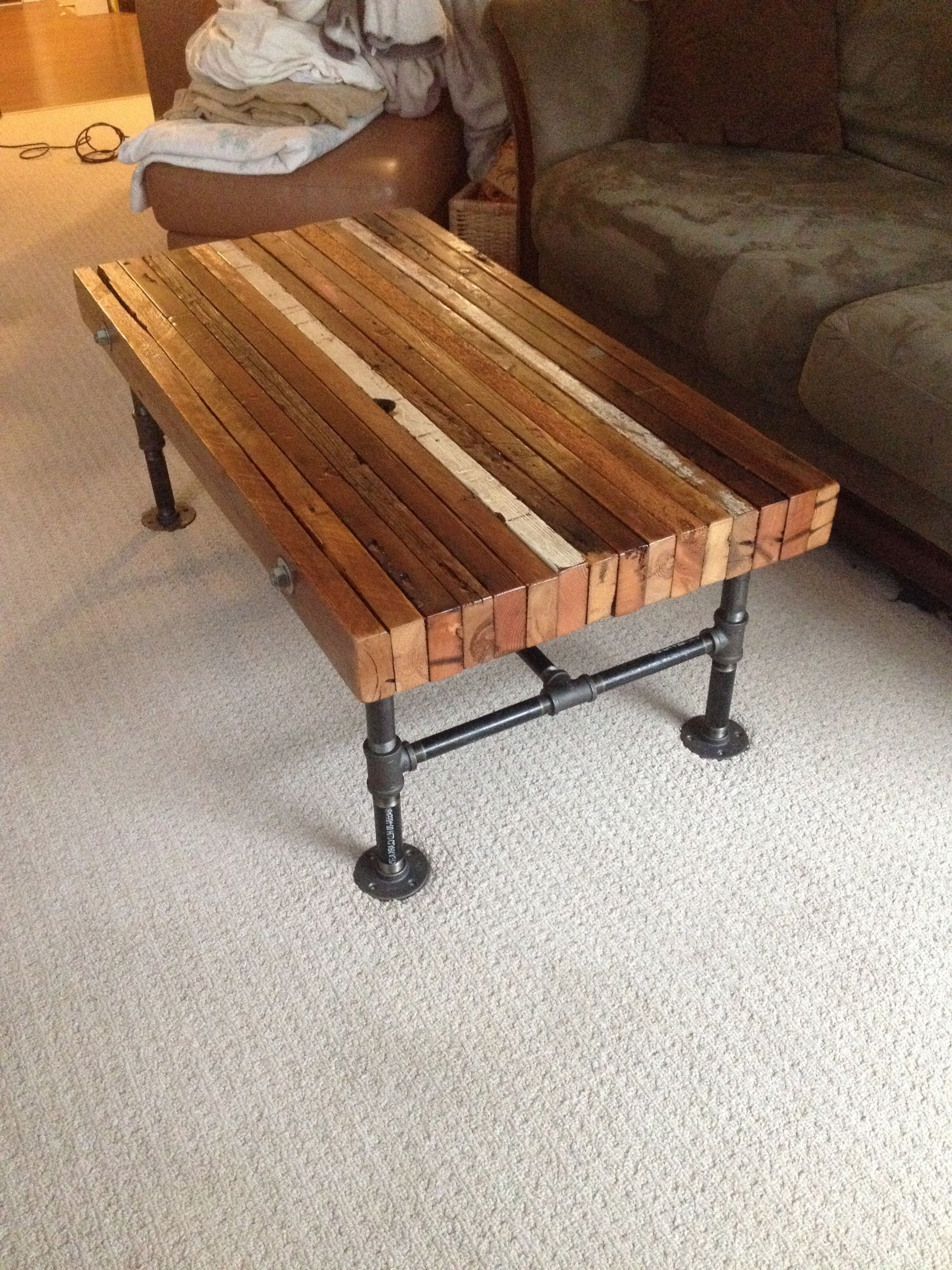 Fashionable Aged Iron Cube Tables Pertaining To Coffee Table Made From Old 2X4S And Black Iron Pipe (View 9 of 20)