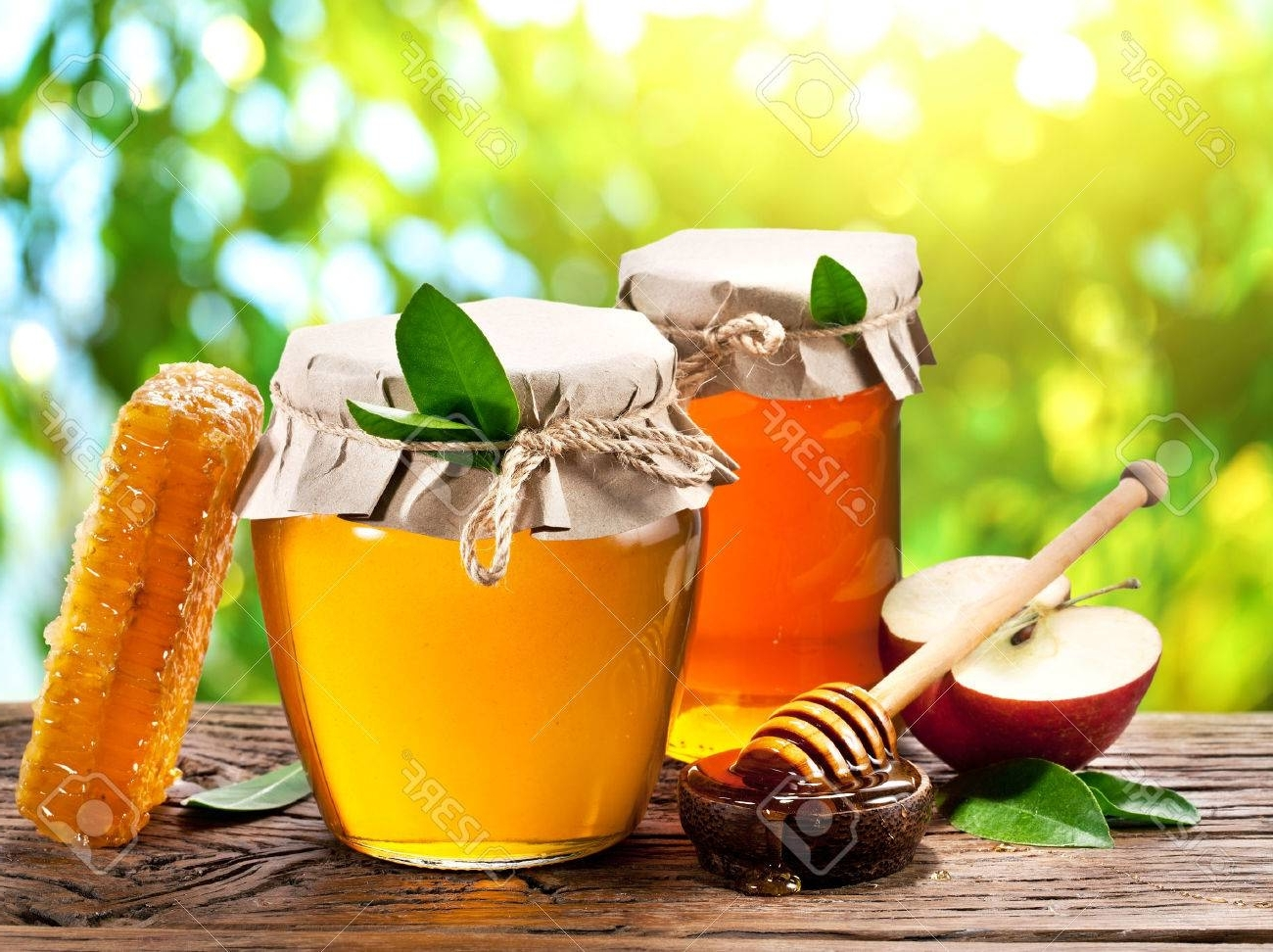 Glass Cans Full Of Honey, Apples And Combs On Old Wooden Table Pertaining To Latest Combs Cocktail Tables (View 7 of 20)