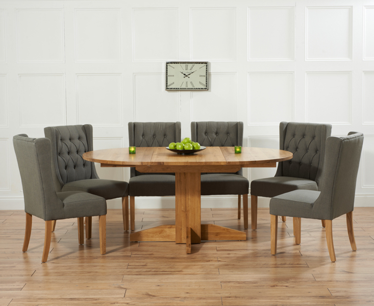 2018 Round Extending Dining Tables And Chairs With Regard To Dorchester 120Cm Solid Oak Round Extending Dining Table With Safia (View 2 of 20)