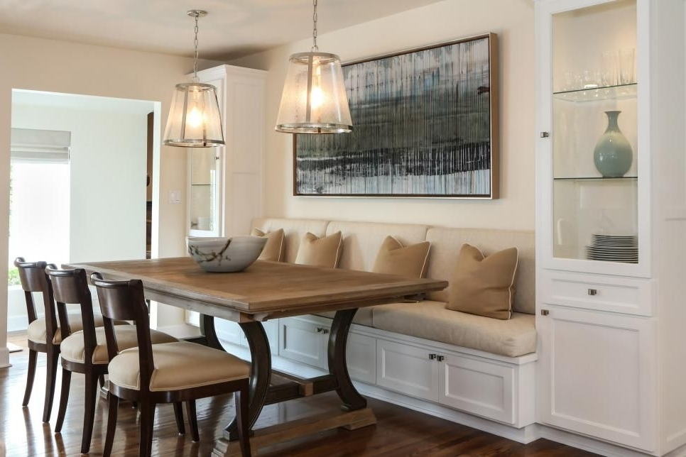 A Built In Banquette Is Flankedtall Glass Cabinets For Storing In Best And Newest Bale 7 Piece Dining Sets With Dom Side Chairs (Gallery 3 of 20)