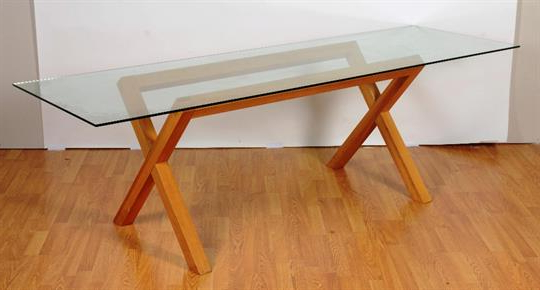 A Contemporary Glass Dining Table, The Rectangular Top On Oak Regarding Well Known Glass Dining Tables With Oak Legs (View 1 of 20)