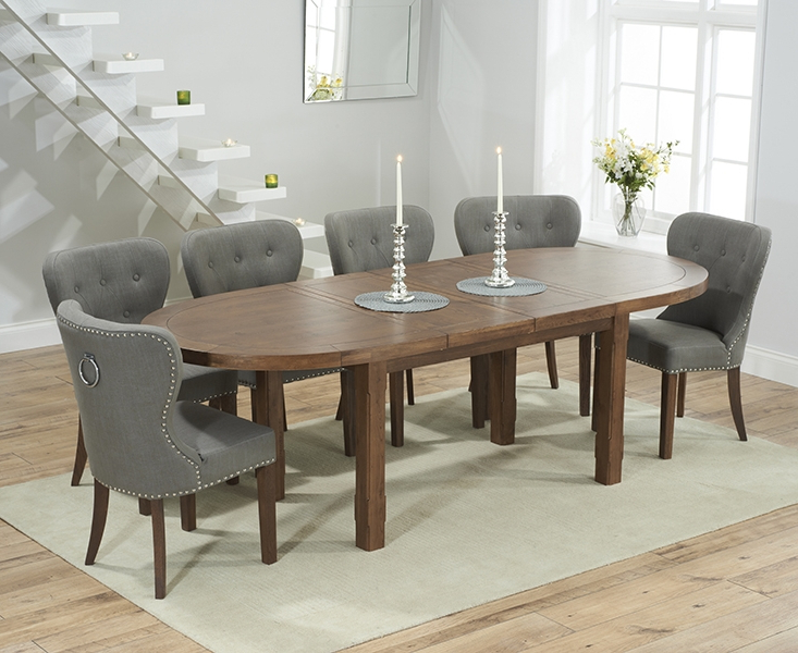 Agata Solid Dark Oak Oval Extending Dining Set With 4 Vicenza Grey Regarding Well Liked Oval Extending Dining Tables And Chairs (View 1 of 20)