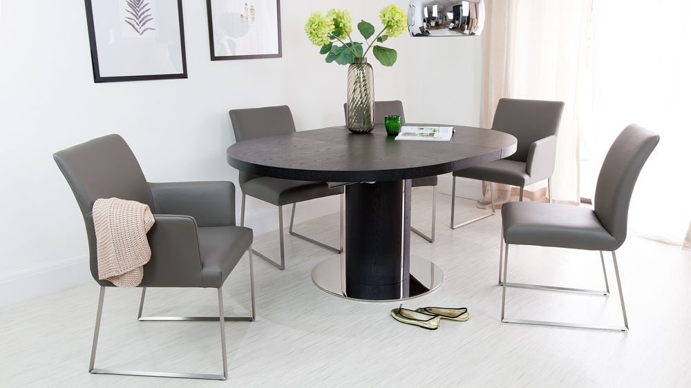 Black Extendable Dining Tables Sets Intended For Recent Black Ash Round Extending Dining Table (View 4 of 20)