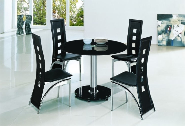 Black Glass Dining Tables And 4 Chairs Regarding Famous Planet Black Round Glass Dining Table With Alison Chairs (View 9 of 20)