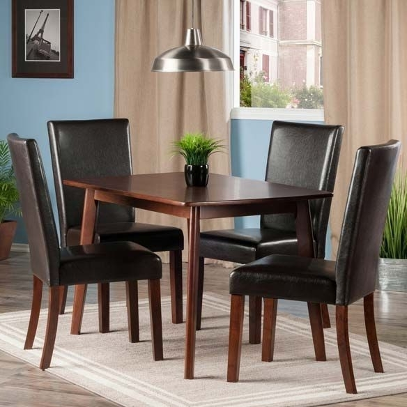Caden 6 Piece Dining Sets With Upholstered Side Chair For Most Recent Shaye Walnut 5 Piece Dining Room Set With Upholstered Chairs From (View 16 of 20)