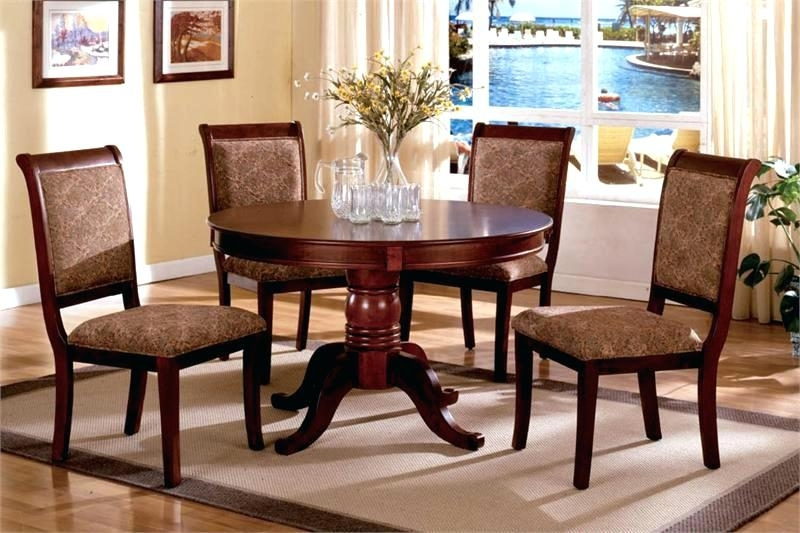 Caira Black Round Dining Tables For Famous Ciara Dining Set – Ocane (View 4 of 20)
