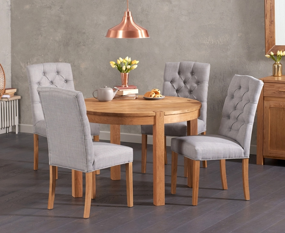 Candice Ii Round Dining Tables Throughout Famous Verona 110cm Solid Oak Round Table With Candice Fabric Chairs (View 6 of 20)