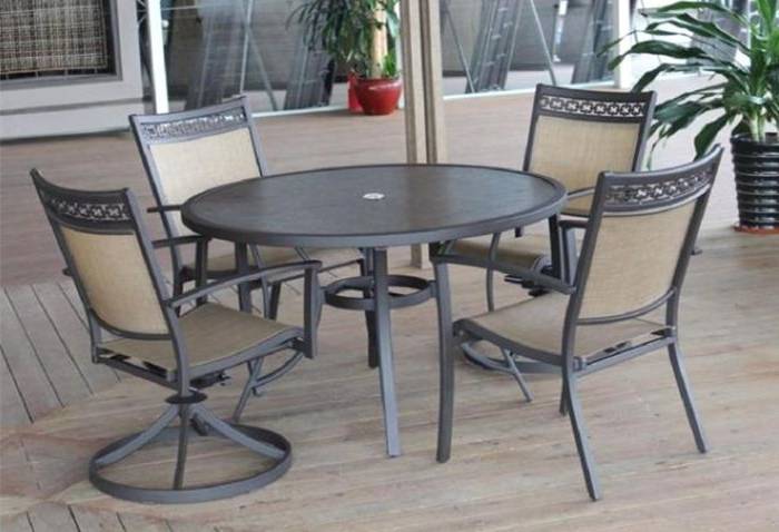 Carmadelia Outdoor 5 Piece Round Dining Set In Tan/brown Pertaining To Well Known Grady 5 Piece Round Dining Sets (View 11 of 20)