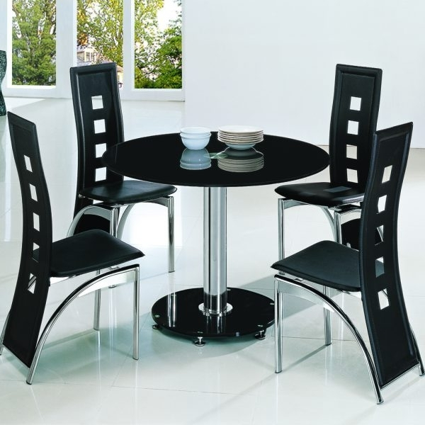 Cheap Glass Dining Tables And 4 Chairs Within Well Liked Planet Black Round Glass Dining Table With Ashley Chairs – Implex (View 8 of 20)
