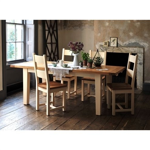 Cotswold Dining Tables Throughout Fashionable Cheltenham Cream 180Cm 230Cm Ext. Table And 6 Ladderback Chairs (Gallery 16 of 20)