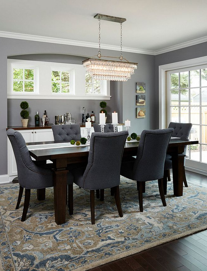 Dark Wood Dining Room Furniture In Latest Dining Room With Dark Wood Floors, Beautiful Patterned Rug And Blue (View 7 of 20)