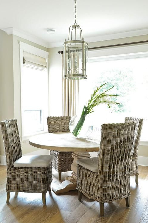 Famous Rattan Dining Tables Throughout Round Salvaged Wood Dining Table With Wicker Dining Chairs (Gallery 4 of 20)