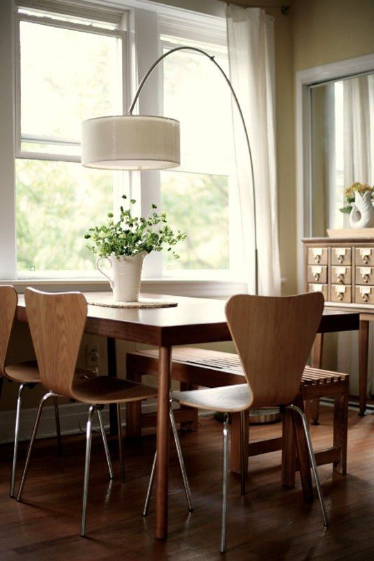 Lighting For Dining Tables For Trendy An Arc Lamp Illuminates The Dining Table (Gallery 1 of 20)
