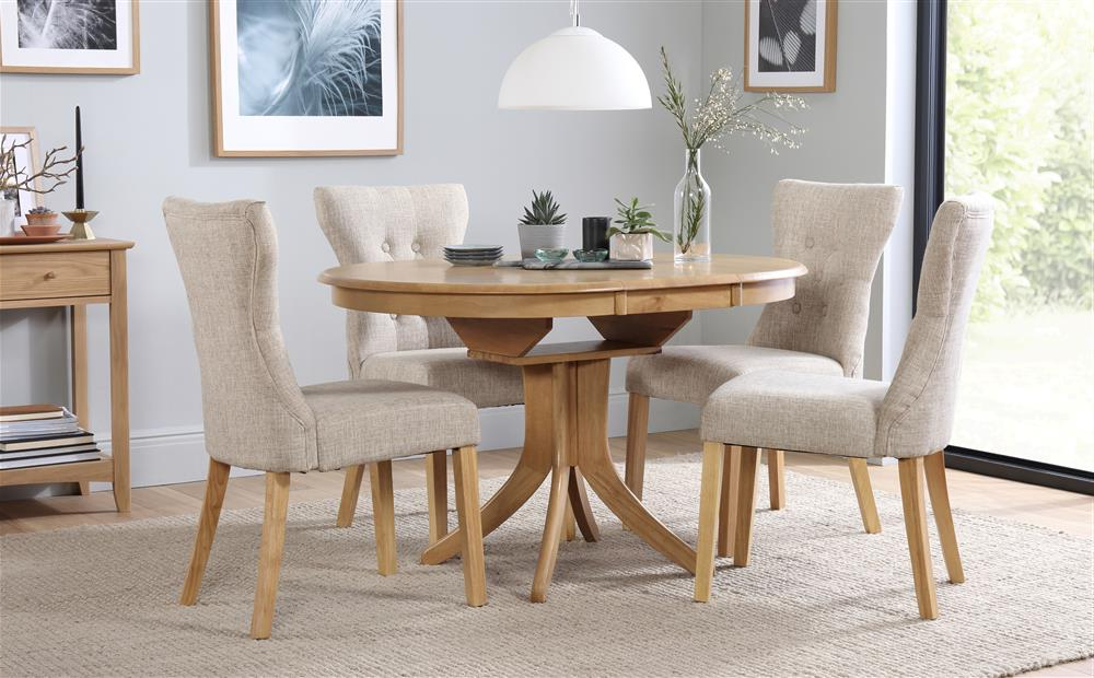 Most Recent Round Extending Oak Dining Tables And Chairs Regarding Hudson & Bewley Round Extending Oak Finish Dining Table & 4 6 Chairs (View 10 of 20)