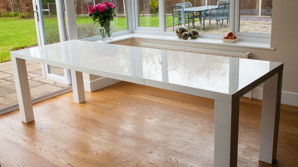 Newest Gloss White Dining Tables Regarding Fern White Gloss Extending And Eames Style Dining Set (View 15 of 20)