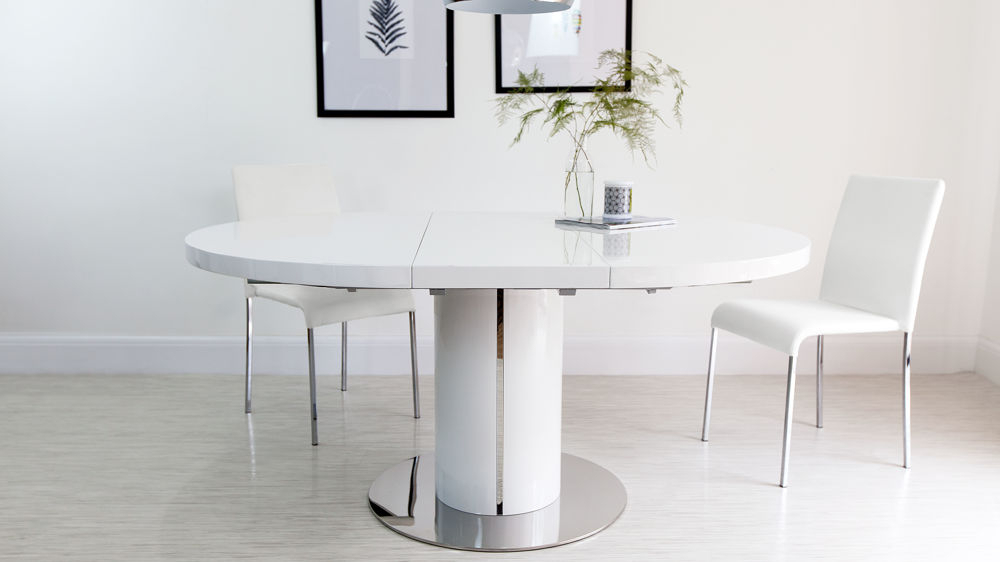 Pedestal Polished Steel Trim Inside White Round Extending Dining Tables (Gallery 1 of 20)
