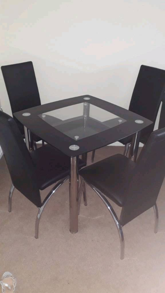 Perth Glass Dining Tables With 2018 Glass Dining Table And 4 Chairs (View 13 of 20)