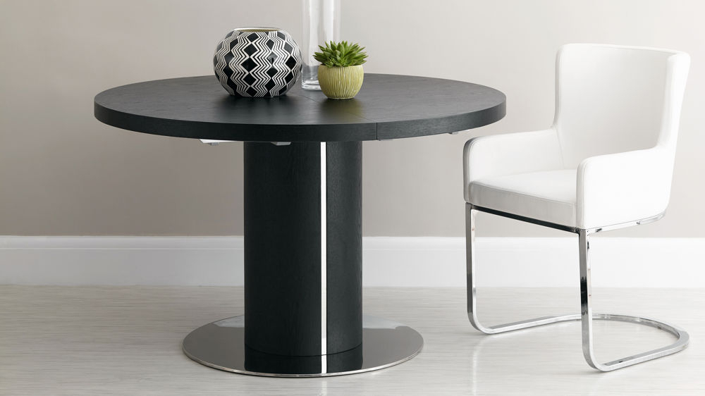 Round Dining Tables Extends To Oval Within Best And Newest Black Ash Round Extending Dining Table (View 16 of 20)