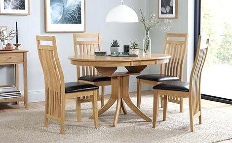 Round Extendable Dining Tables And Chairs With Well Known Extending Dining Table Chairs Uk Oak And Ebay Black Glass 8 Round (View 11 of 20)