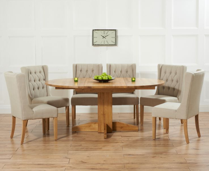 Round Extending Dining Tables And Chairs Intended For Trendy Dorchester 120Cm Solid Oak Round Extending Dining Table With Safia (View 14 of 20)
