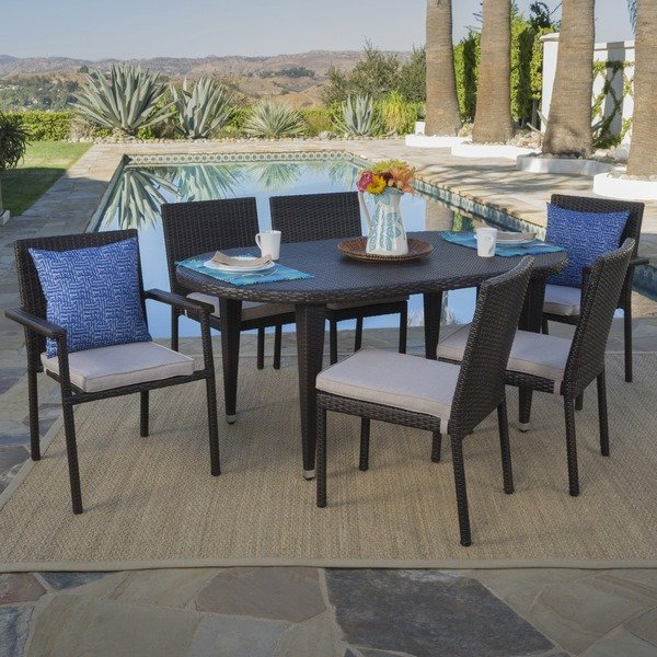 Shop Logan Outdoor 7 Piece Oval Wicker Dining Set With Cushions Within 2018 Logan 7 Piece Dining Sets (View 12 of 20)
