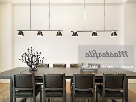 Simple Dining Table In Modern Home With Hanging Lights – Stock Photo With Regard To Trendy Dining Tables Lights (View 19 of 20)