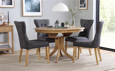 Featured Photo of Round Extendable Dining Tables And Chairs