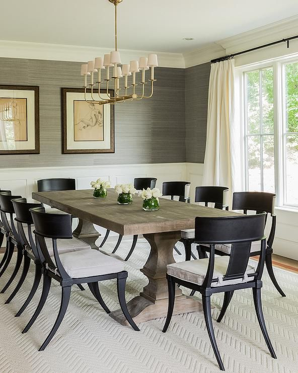 Transitional Dining Room Features Upper Walls Clad In Gray Intended For Favorite Helms 5 Piece Round Dining Sets With Side Chairs (View 18 of 20)