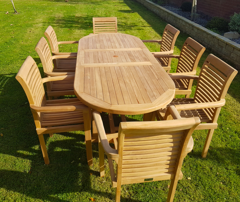 Well Liked Teak Garden Furniture Extending Teak Dining Table With 8 Stacking Chairs Regarding Garden Dining Tables (View 20 of 20)