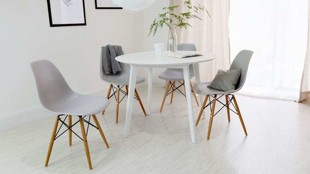 White Circle Dining Tables Regarding Trendy Round White Dining Table And Eames Dining Chair Set (View 16 of 20)