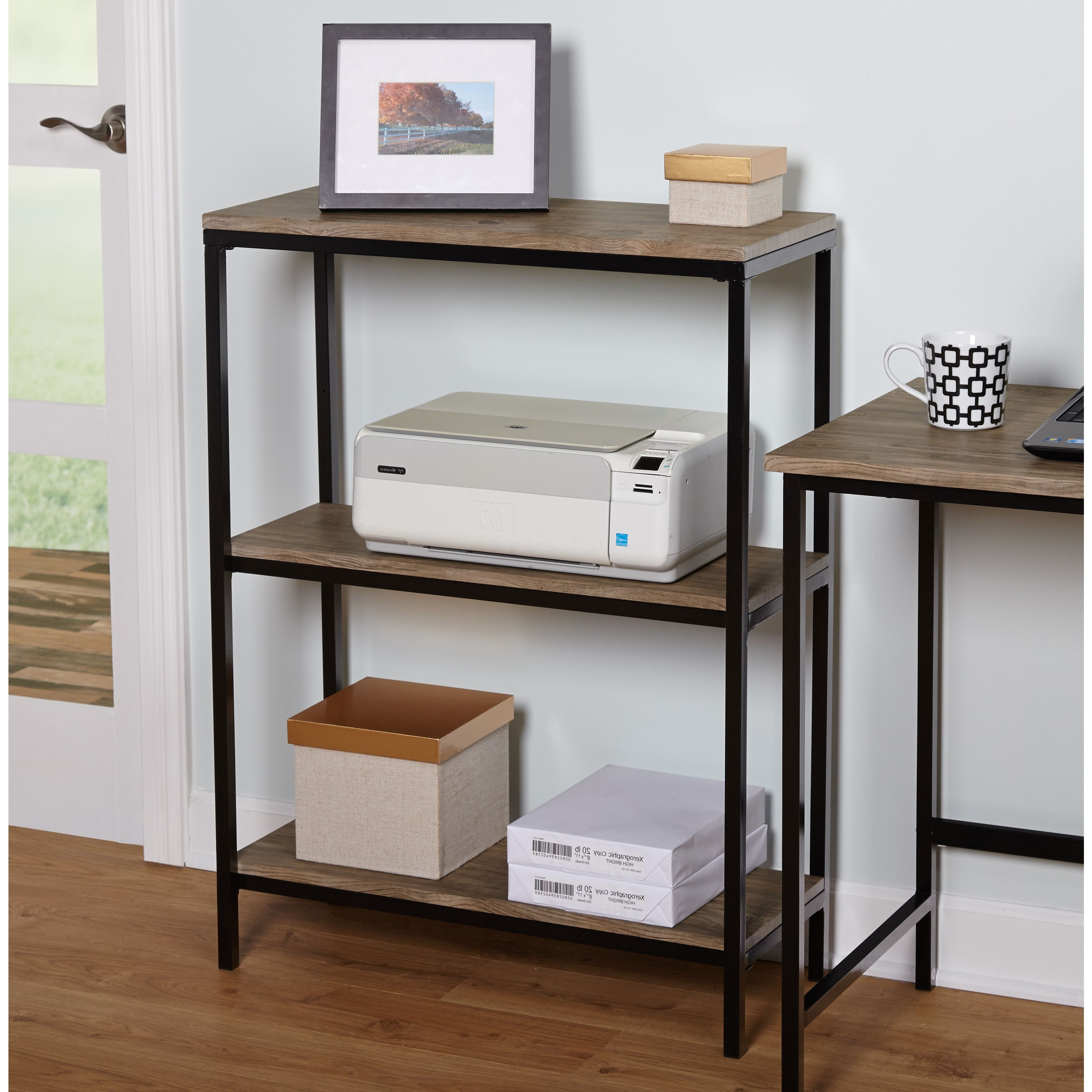 The Piazza 3 Tier Bookshelf From Simple Living Features A Bold Black For Mix Patina Metal Frame Console Tables (View 14 of 20)