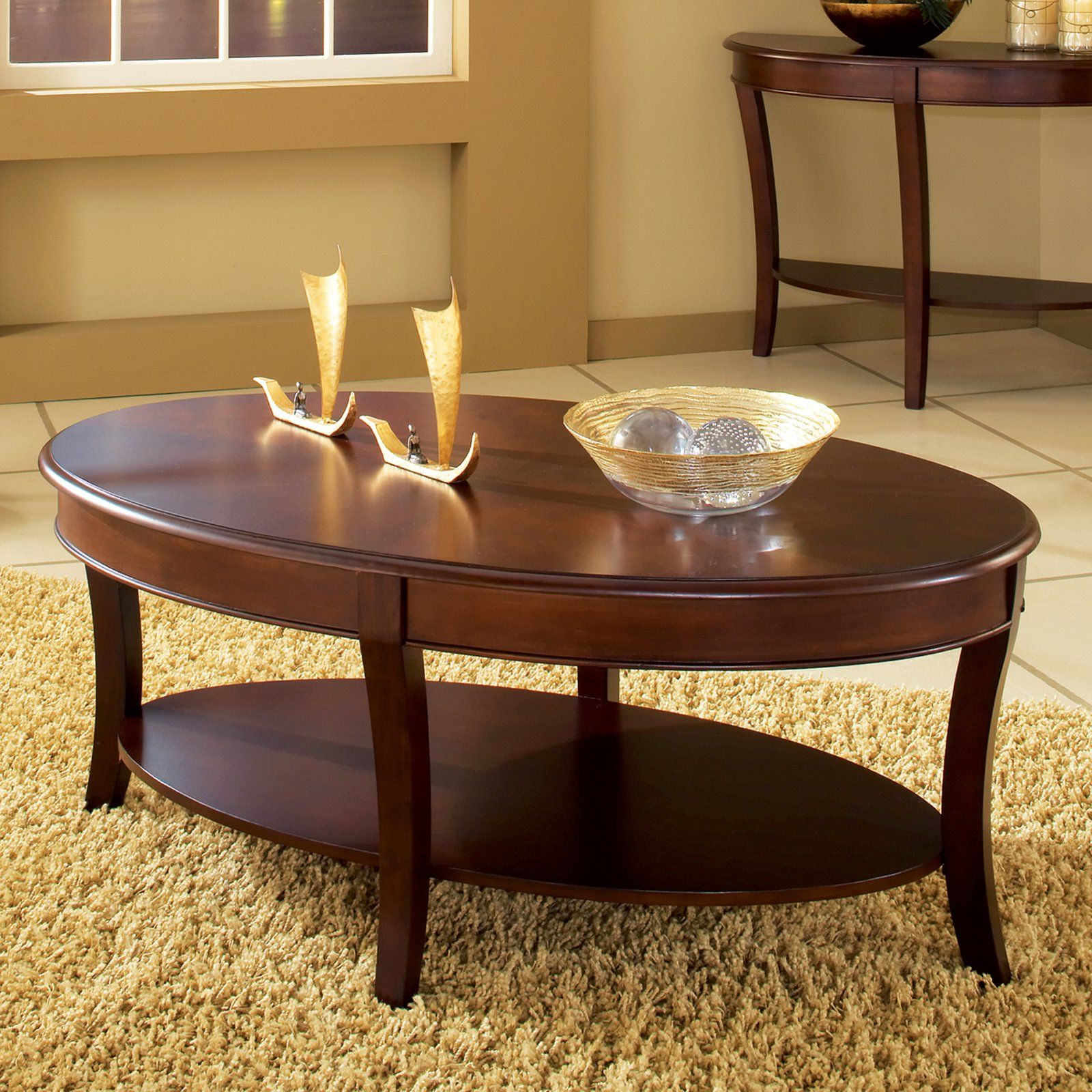 From With Regard To Well Liked Winslet Cherry Finish Wood Oval Coffee Tables With Casters (View 6 of 20)