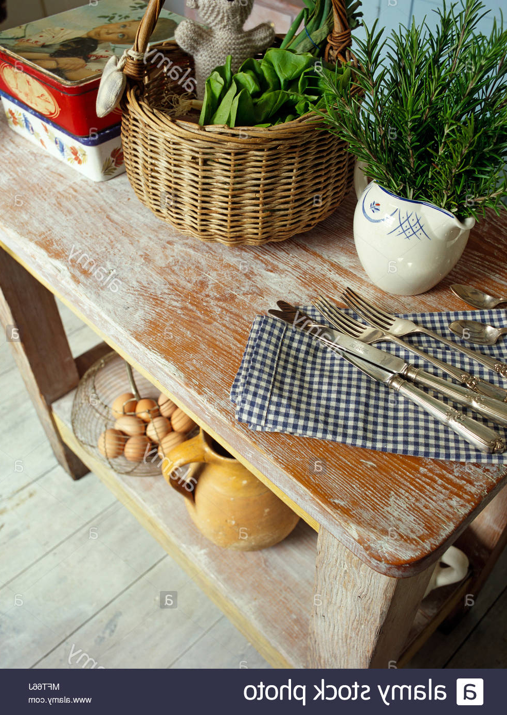 Popular Rustic Coffee Tables With Wicker Storage Baskets In Wicker Basket And Cutlery On Rustic Wooden Table Stock Photo (View 19 of 20)