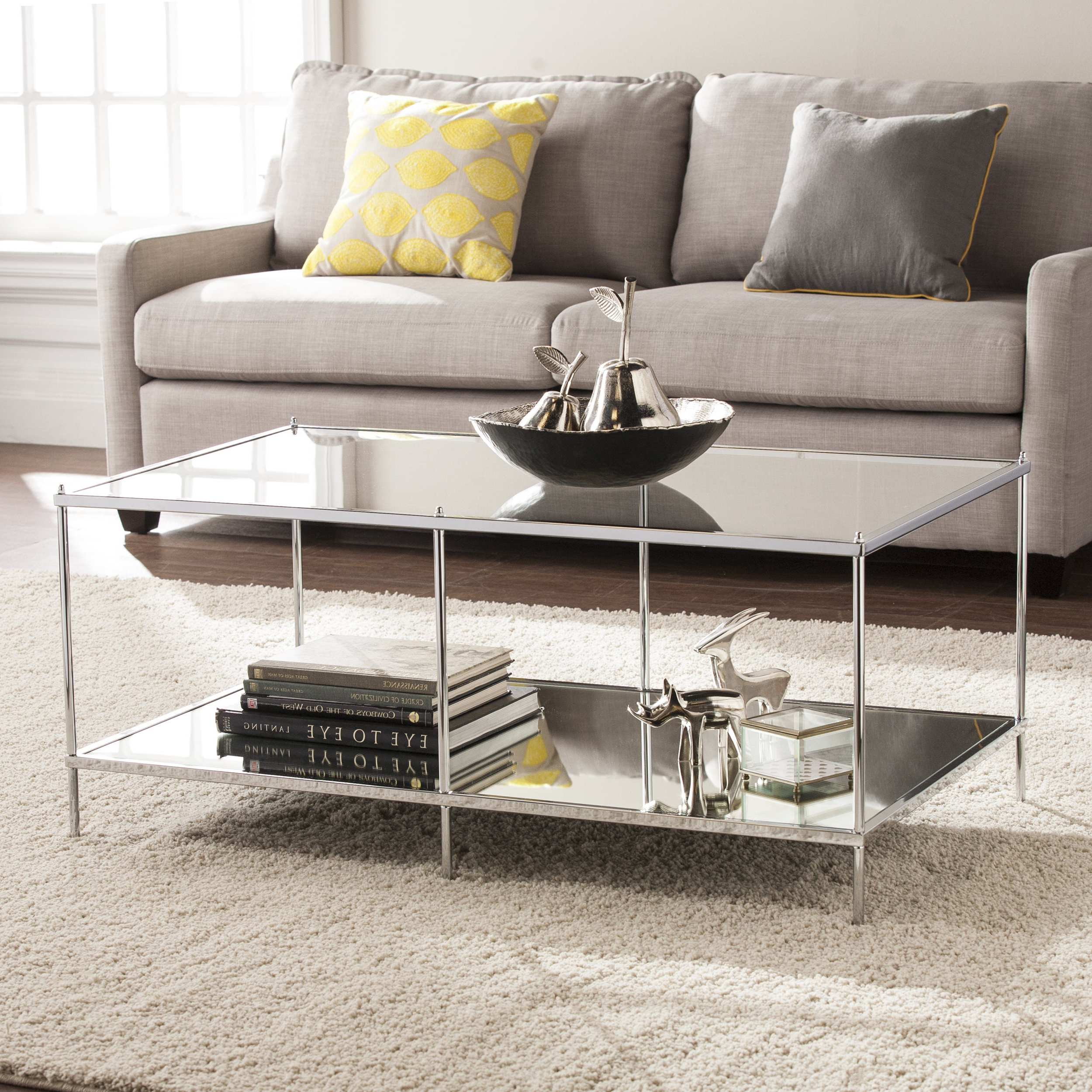 Silver Orchid Olivia Mirrored Chrome Cocktail Table Pertaining To Most Current Silver Orchid Olivia Chrome Mirrored Coffee Cocktail Tables (View 5 of 20)